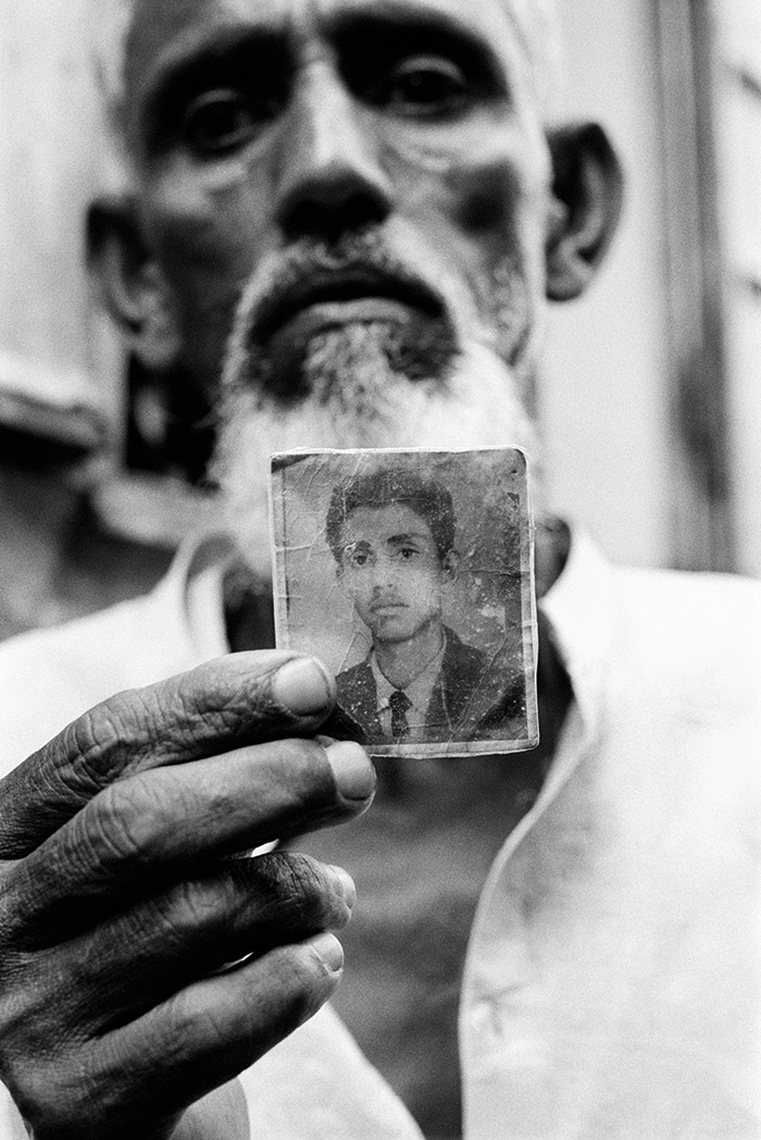 Before 1971, the Bihari owned land, held government jobs and were prosperous members in the community. A 60-year-old man in Pat Godam Camp in the town of Mymensingh holds a photo of himself at the age of 19.