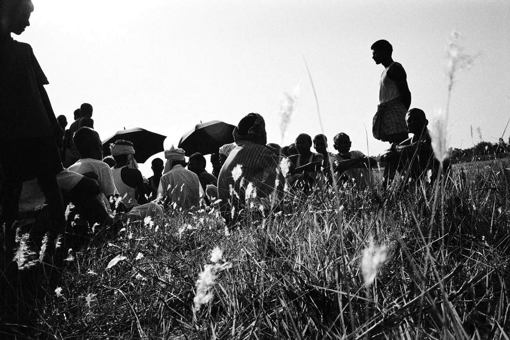 Dalit gather on the banks of the Kuti River in the Terai for a burial ceremony of an older man from the community.