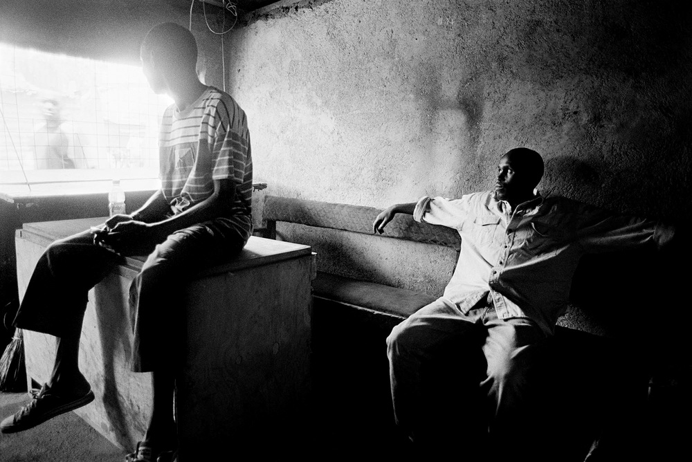 Two unemployed young Nubians sit in a youth centre in Kibera. For years, young Nubians had to go through a nationality verification process called vetting, which caused difficulties for Nubian youth to obtain National ID cards.