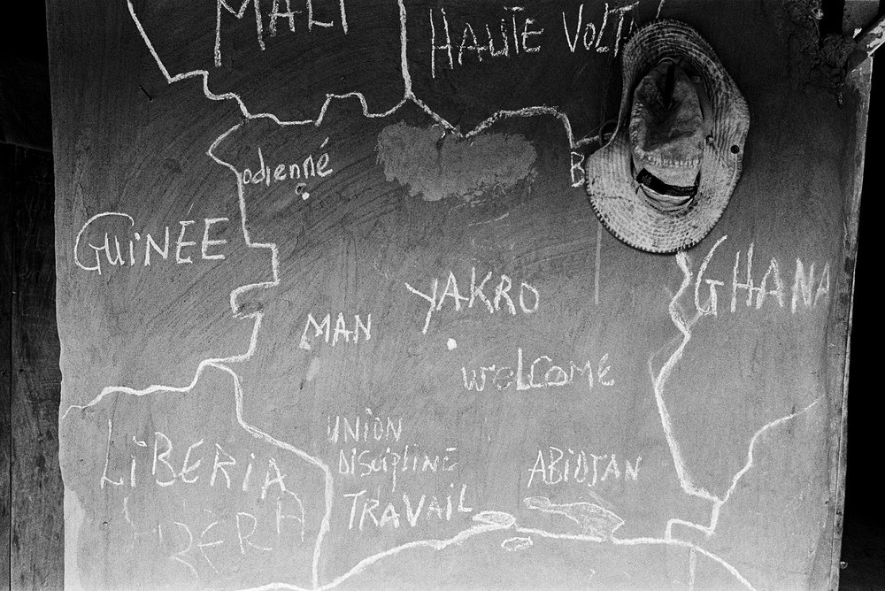 A map of West Africa is drawn in chalk on the wall of a home in a remote village in southwestern Côte d'Ivoire. The nationality of hundreds of thousands in Cote d'Ivoire is in question.