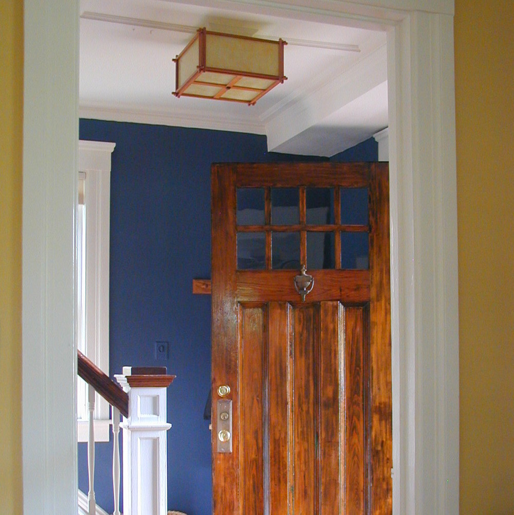 Amy Woolf Color Consulting  www.awcolor.com  Moody navy blue walls for a dark foyer
