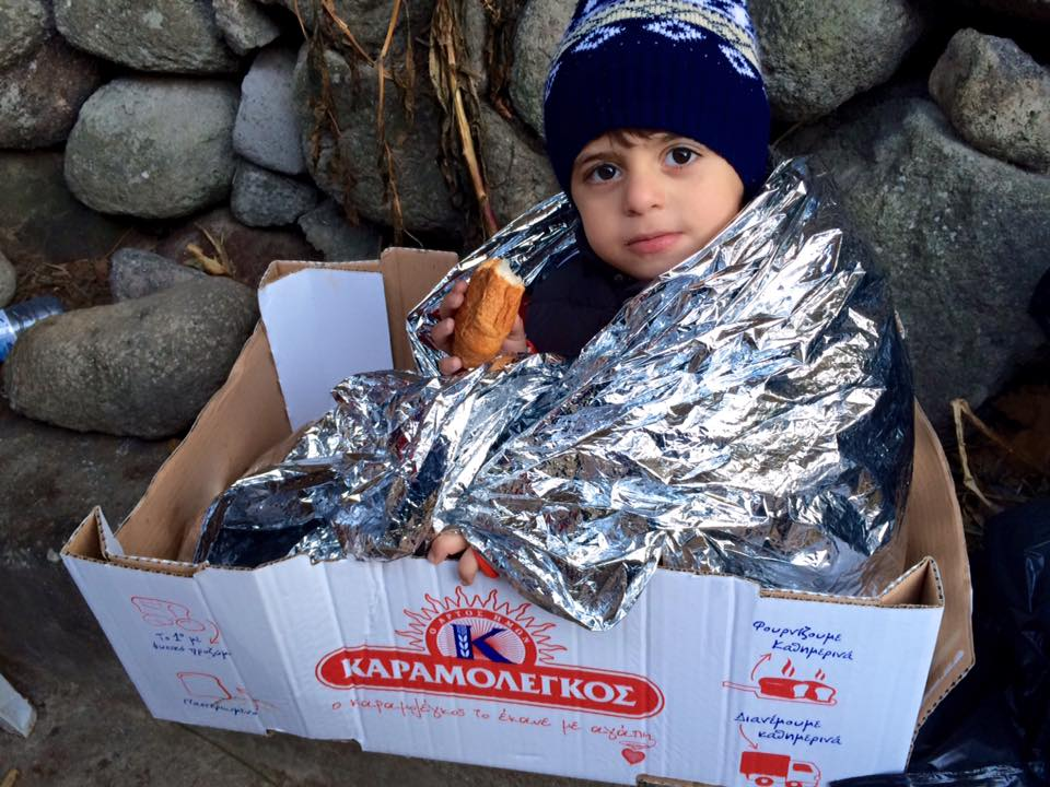 kid in a mylar blanket with food.jpg