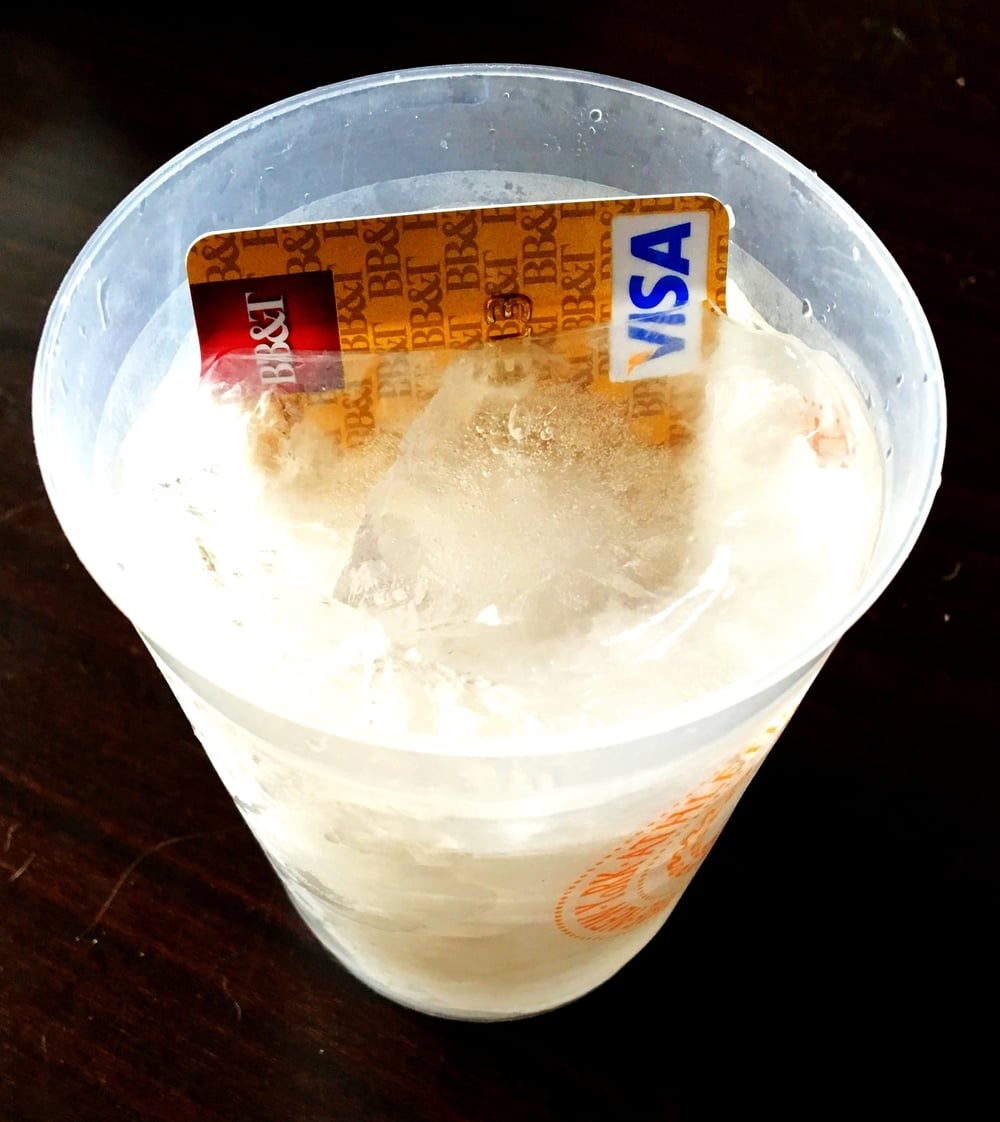 All you need is a cup and some water to be on your way to freedom from credit card debt...