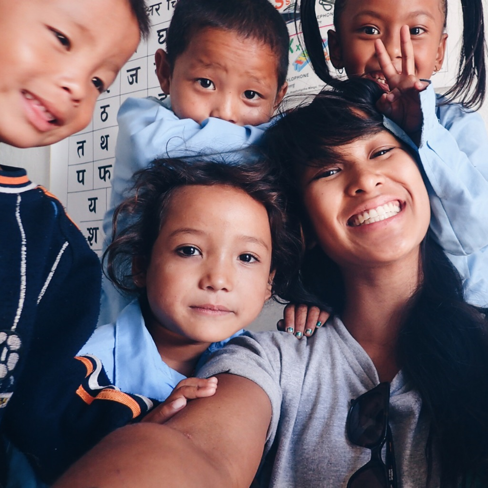 Taking selfies with the children of Ghusel, Nepal