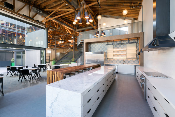 The open kitchen area at 720 North Cahuenga. The building is part of a movement to rejuvenate spaces for tech and media businesses, but it also has drawn interest from traditional fields like law and insurance, which hope the spaces can foster collaboration.  CreditColey Brown for The New York Times