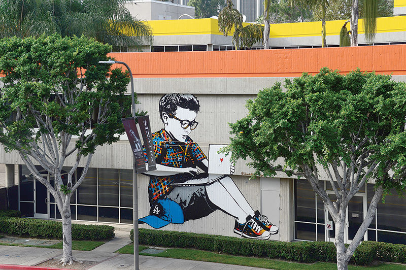 Property owner Rising Realty Partners tapped an artist known as Bumblebee, who has a strong online following, to do a mural on the City West office complex Park DTLA. photo by Gary Leonard