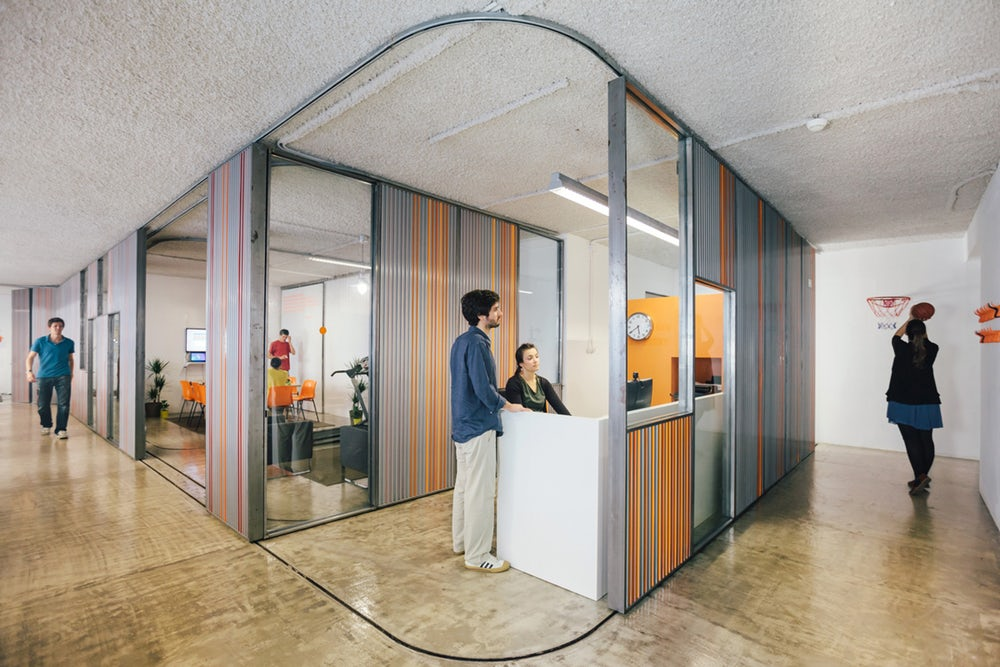 Sliding office walls to allow closed-door office-time or open door meeting spaces