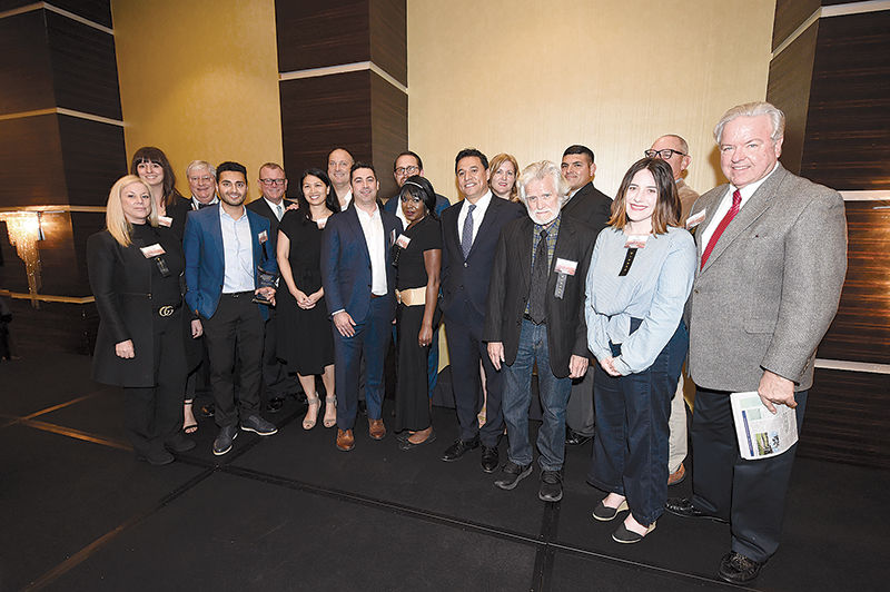 Representatives of 10 projects that won 2017 Downtowners of Distinction awards gathered together at a ceremony last week.  Photo Credit: Gary Leonard, Downtown Ners