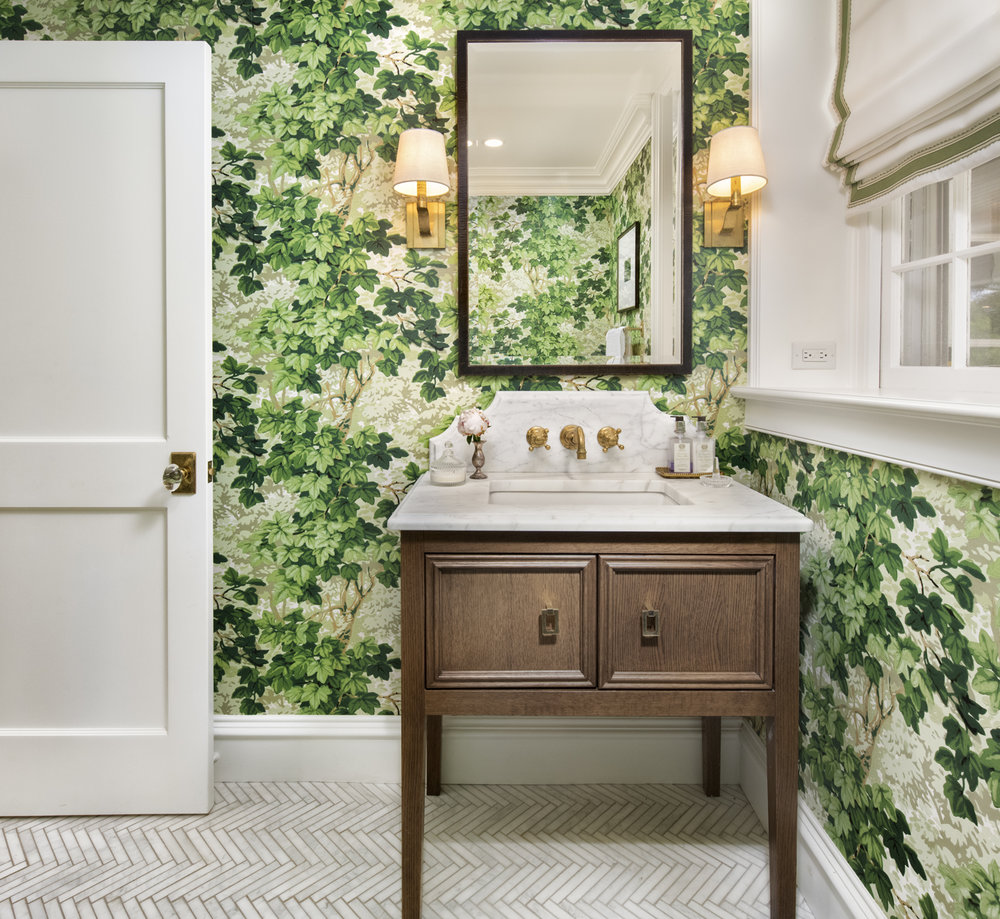 Is this not the coolest wallpaper for a bathroom? Wallpaper is on the comeback. Rittenhouse Builders