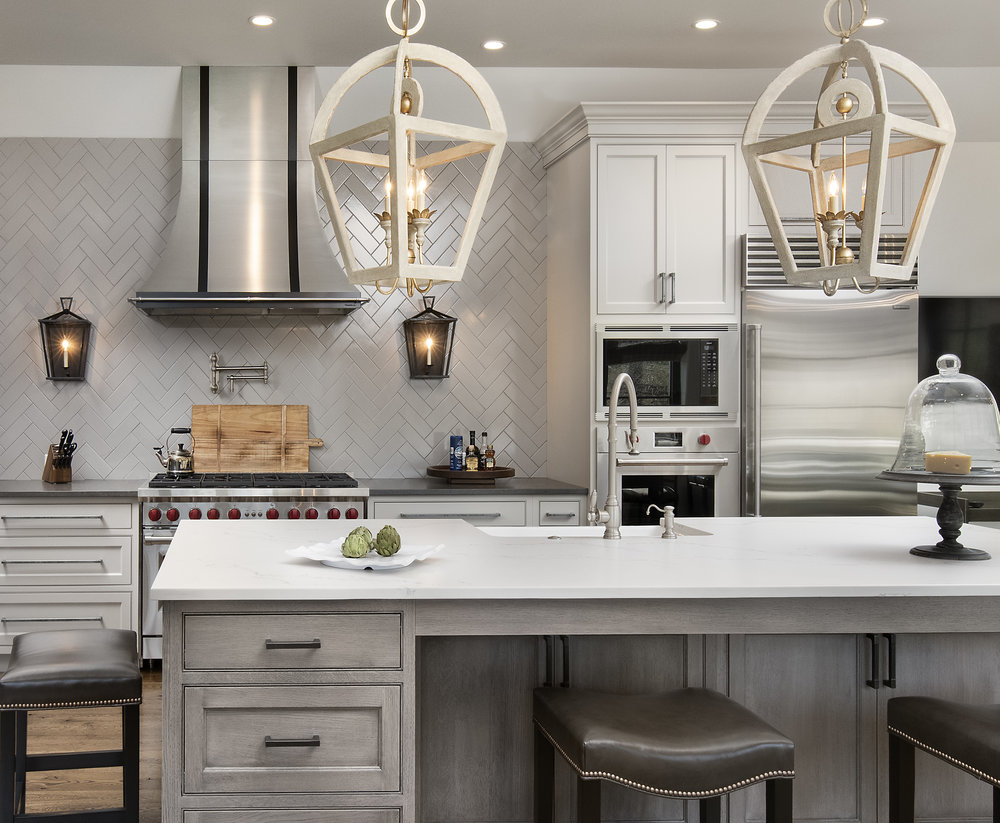 Kitchen by Waterbury Design. The lights above the island were hard to match up during the shot. They would keep becoming unaligned. So, I had to align them and quick fire a shot before they would spin.
