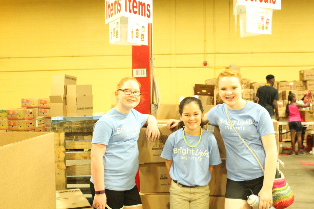Serving at Harvesters during the Caring Leaders camp.