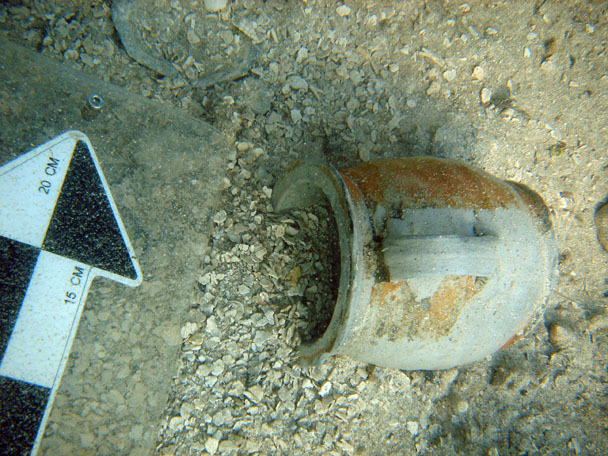 An intact stoneware mug found under the anchor 1 on The Tile Wreck