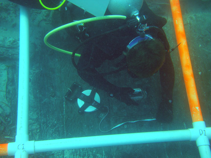 Wesleysurveying and documenting survey square C0 on the wreck site's port amidships.