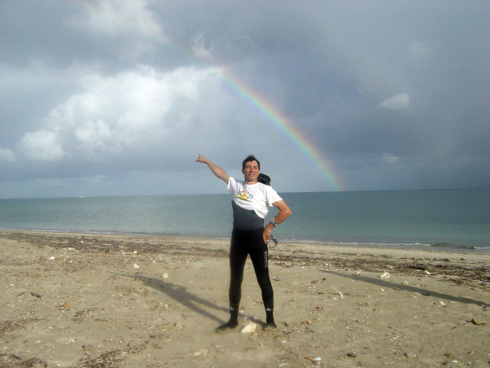 Action man Francois pointing to the wreck site, which happens to be at the end of the rainbow