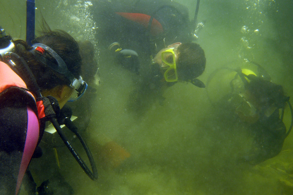 Dr. Chow (left) and Dr. Spooner (centre) training students on   The Tile Wreck