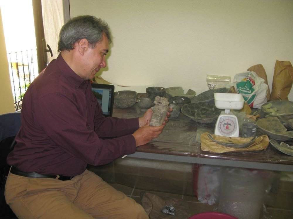 Dr Gendron examining artefacts from Monte Alban Mexico