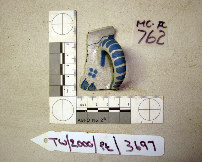 A French blue and white fainceware handle and part side of a mug, from     The Tile Wreck       at ONPCS, showing the two numbering protocols