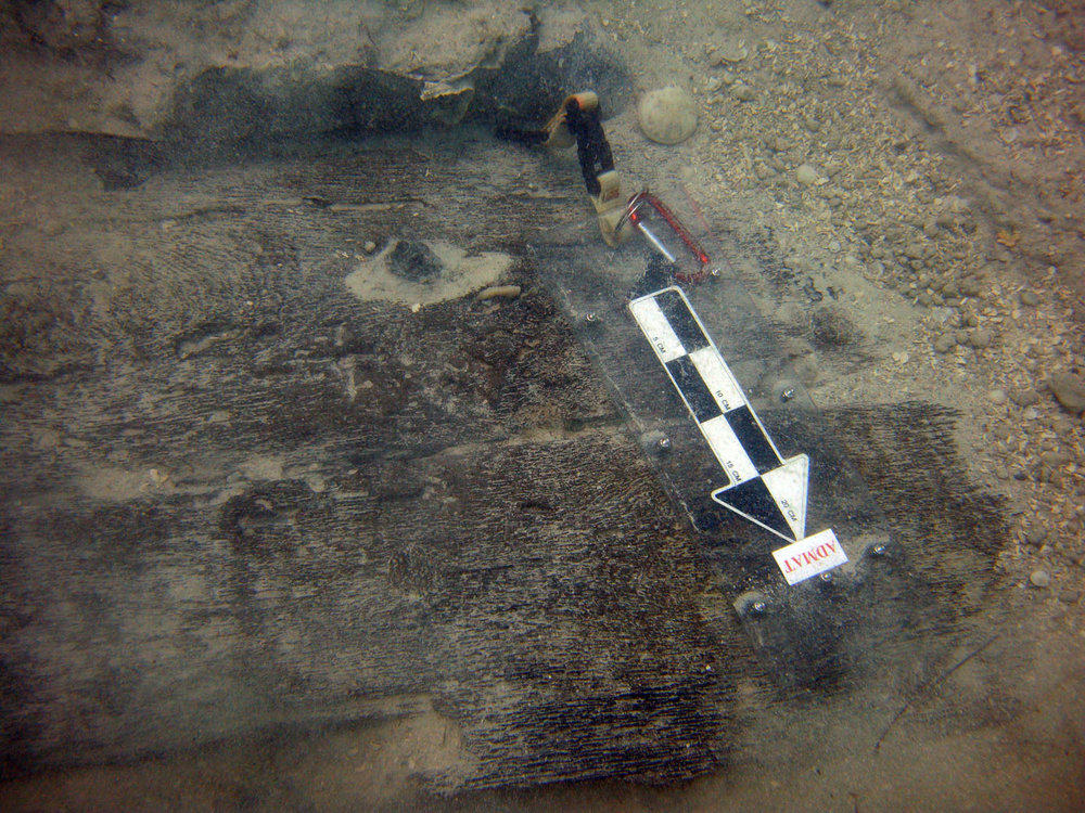 The two pieces of hull planking from Le Dragon with copper sheeting which were found around 50 meters from the break in the hull. It is assumed they were deposited here as a result of the explosion.