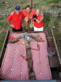 Patrick Enlow, Dr Simon Spooner, Puppy IZI and Christine Nielsen with the Columbus period anchor found by ADMAT in 15 mins in front of Columbus's House at Las Isabella