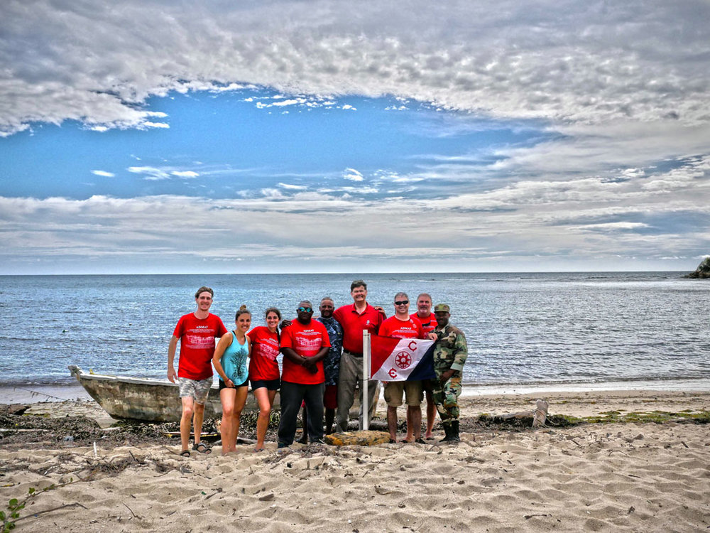 Some of the survey Team on the beach flying the Explorers Club Flag