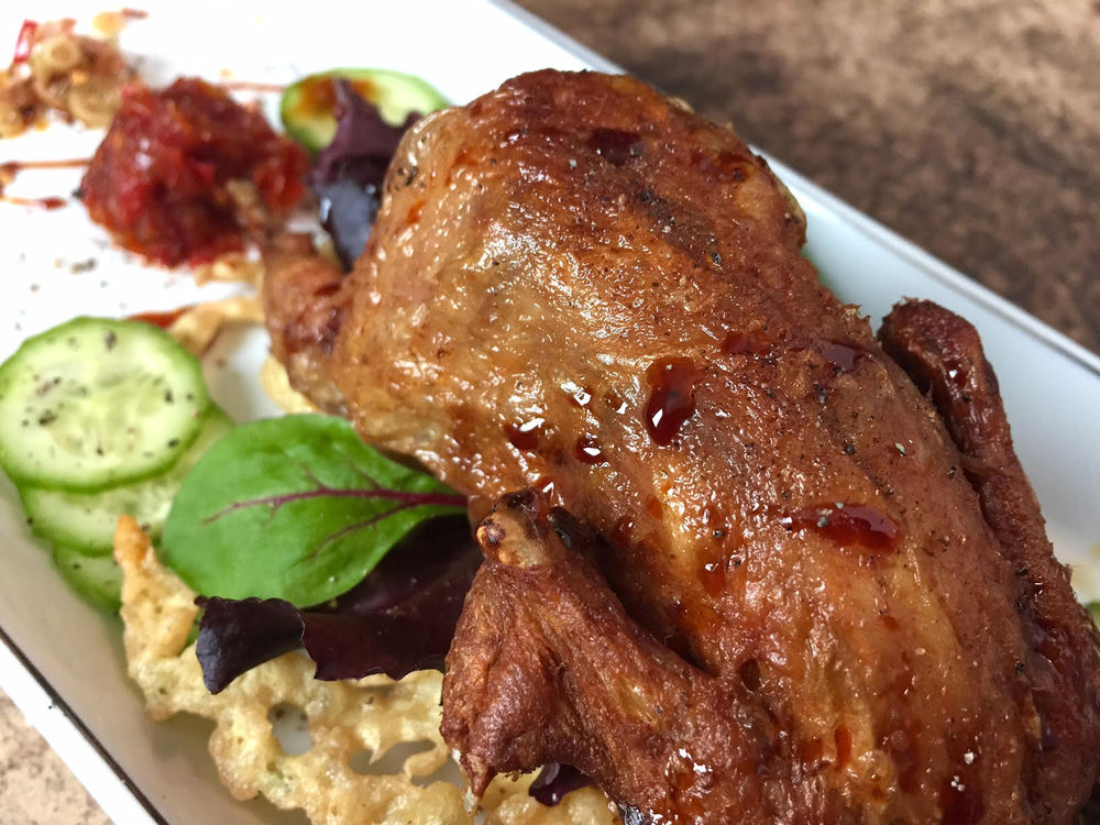 FRIED WHOLE QUAIL IN TAMARIND, GARLIC AND CORIANDER SERVED WITH SPICY LEMONGRASS SAMBAL. PHOTO BY MIRANTI DAME CUCHIFRITA