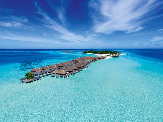 a typical over water bungalows that make the maldives so desirable. check out outrigger resort for an affordable, luxury experience.