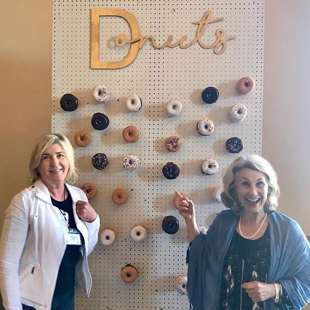 Having a BLAST at the @shewritespress author retreat with my friend @jillg.hall and all my SWP sisters ✨ How cute is this REAL donut wall?  _ #simplejoys #joyissimple #swp #shewritespress #authorretreat #storytellingforchange #memoriesindragonflies