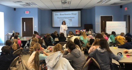 Special guest appearance by veterinarian Dr. Day to meet with Youth Ambassadors and discuss 'a day in the life of a veterinarian.'