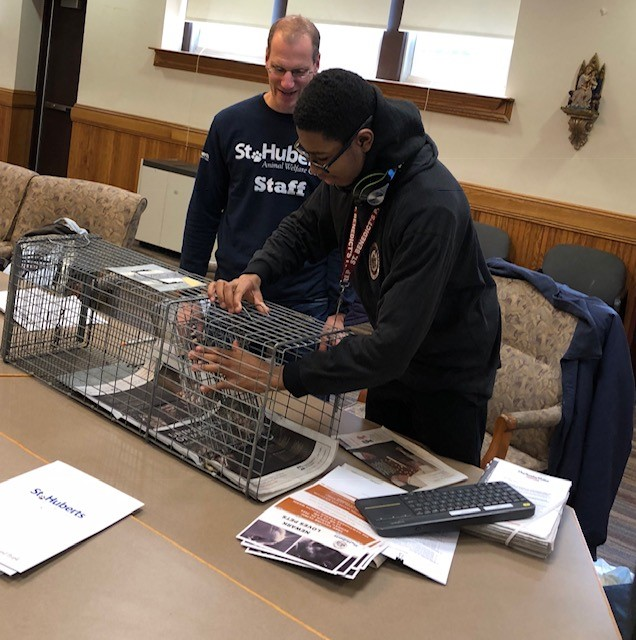 High school students gets hands on experience while learning about Trap Neuter Return.