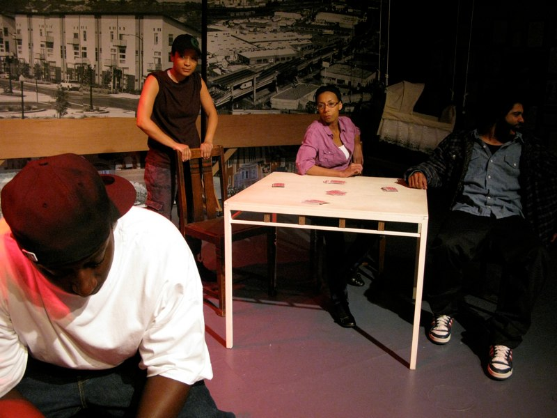The majority of the play took place around a card table. Photo by Joan Osato