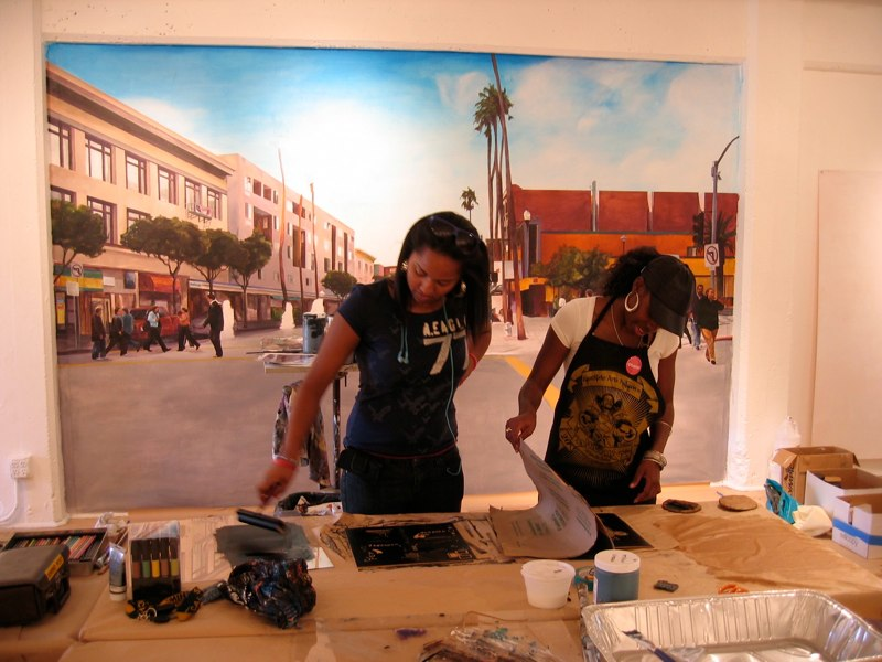 During the exhibit, we hosted a series of free workshops. Here, participants working on their printing technique in a workshop led by Favianna Rodriguez.