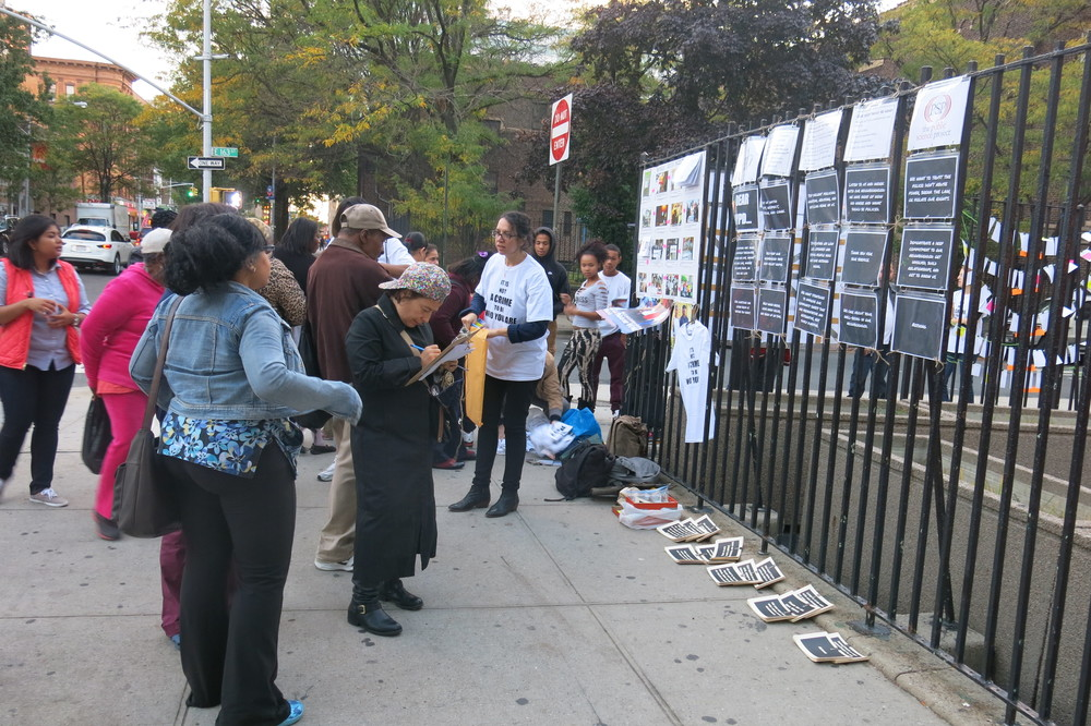 "MJP collects and shares the bulk of its data, reports, posters, stickers and writings through ""sidewalk science"" actions. Here, residents are writing postcards to the NYPD. The postcards also include findings from previous sidewalk science actions, so with each iteration of data collection, the dialogue builds on itself."