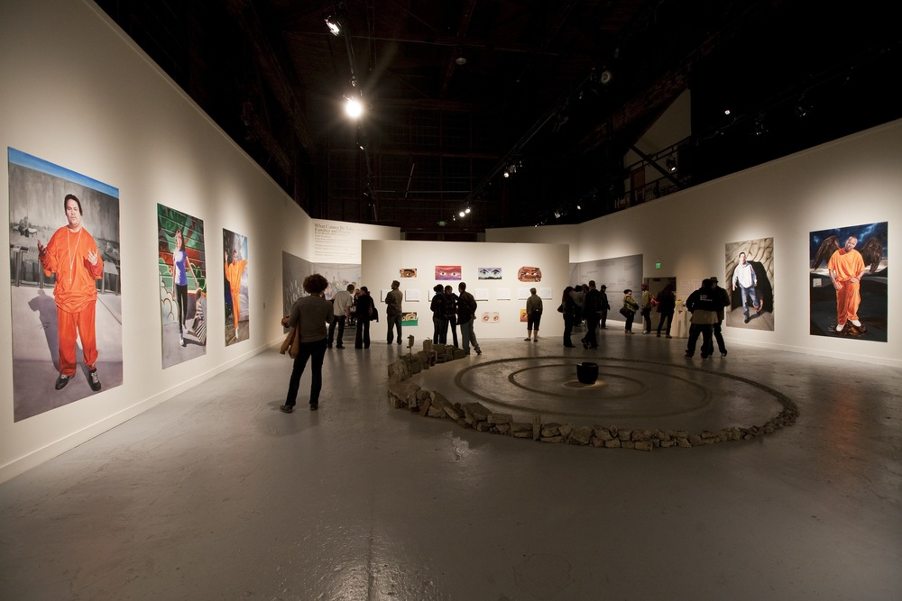 Installation view, including the meditation labyrinth, the eyes paintings by project members and the portraits.