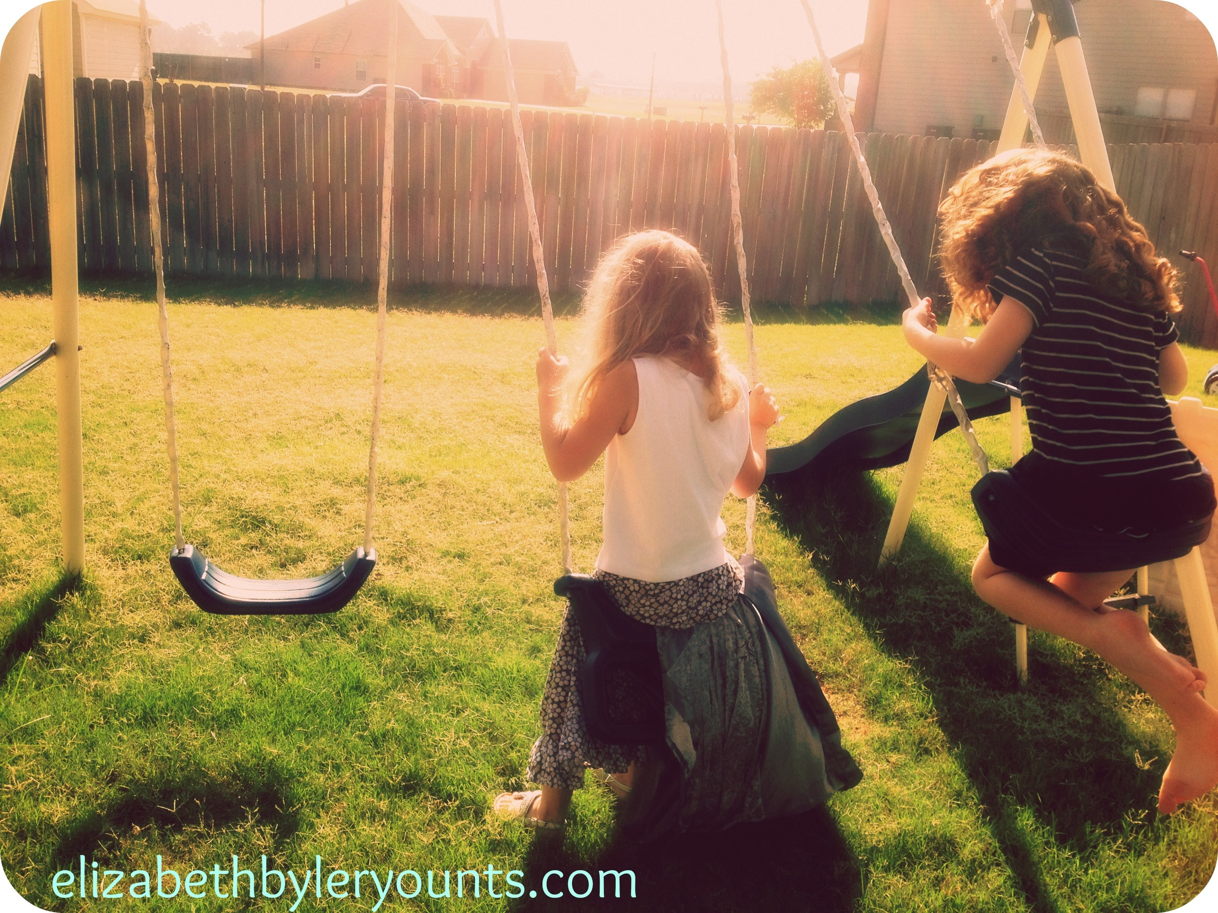 My daughter Curly swinging in our backyard with one of her besties...a military brat living on the other side of the world now.