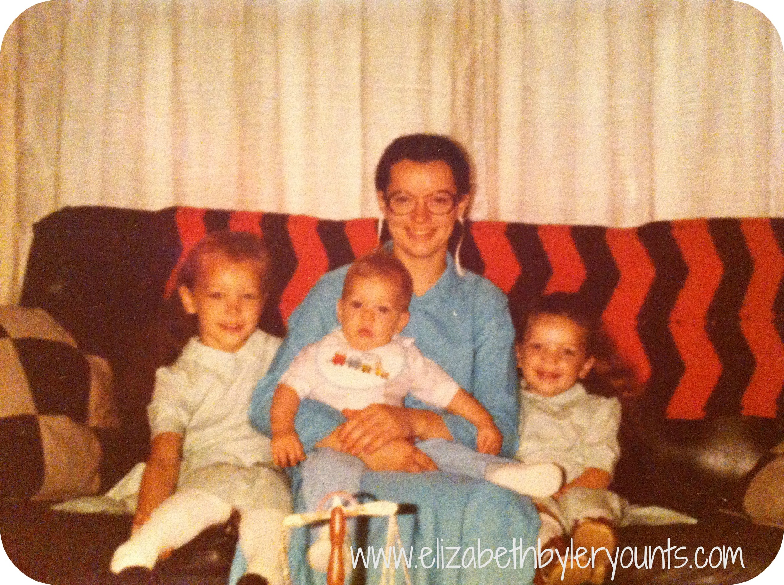 (left to right) my sister Emmalene, my mom Esther holding my brother Joseph, and me