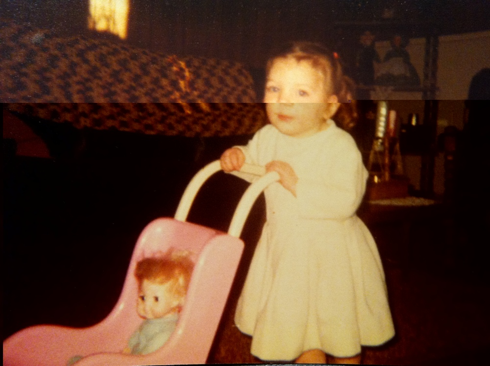 Me as a little Amish girl playing with my doll and stroller.