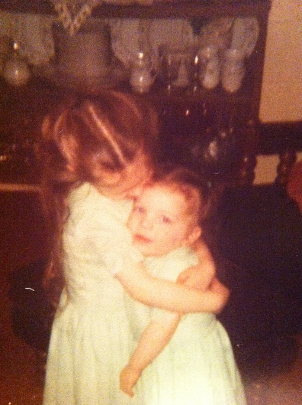 My sister holding me close.