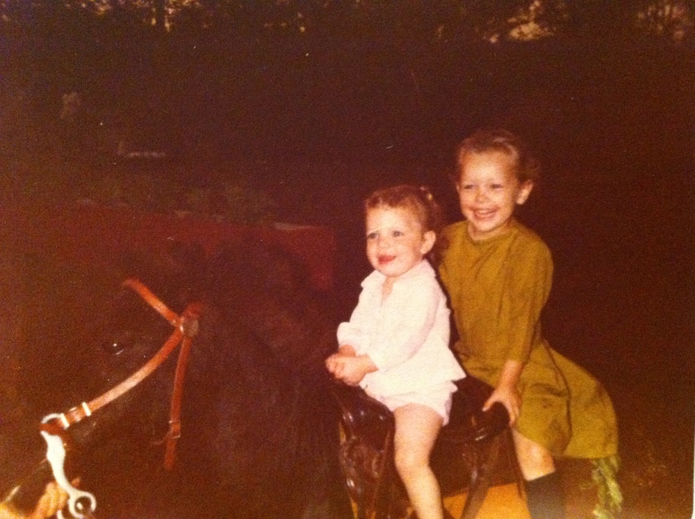Enjoying a pony ride with my sister.