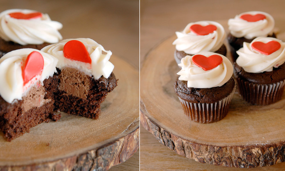 Chocolate Mousse filled Artisan Cupcake with Strawberry Cream Cheese Icing   4.25 each  All American Chocolate cupcake filled with chocolate mousse and topped with strawberry cream cheese icing. Garnished with a fondant heart.   (Available during the month of February)