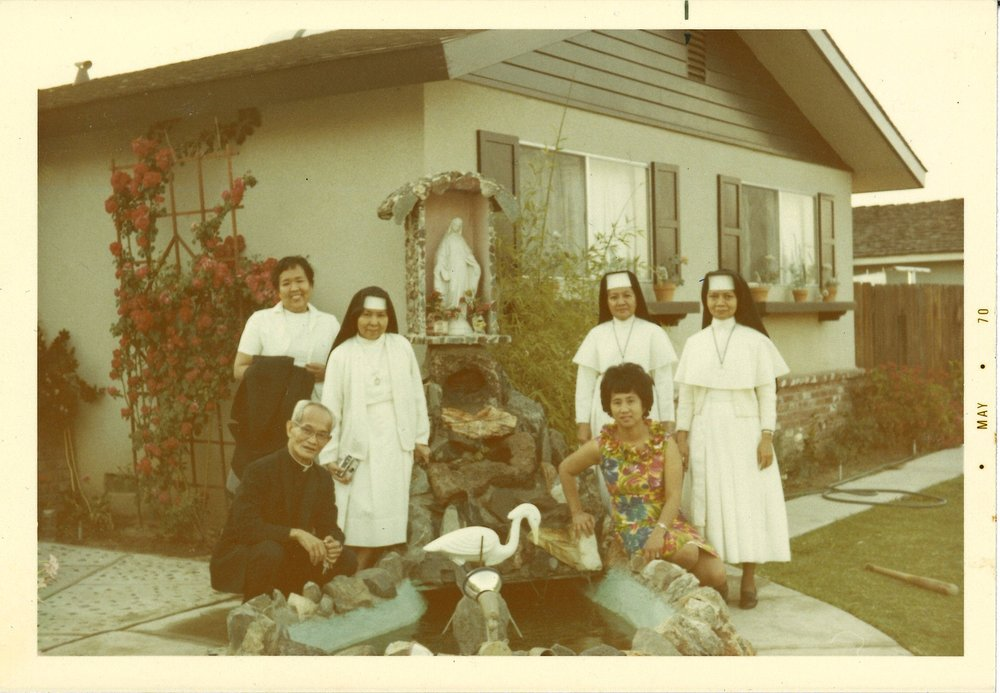 Lola with nuns and priest at the fountain. Sanger, Ca. (1970)