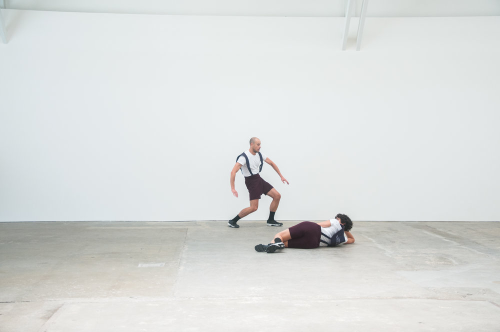 """Adam Linder, Full Service, 2018; installation view, CCA Wattis Institute; """"Choreographic Service No.3: Some Riding,"""" 2015, Duration Variable. Two dancers: Adam Linder and Leah Katz. Photo: Dustin Soriano."""