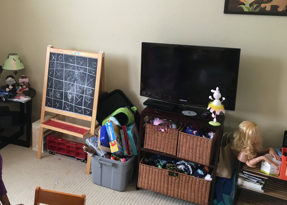 Before: additional limited shelving that didn't meet storage needs for large toys, old TV which was to be moved to new guest room