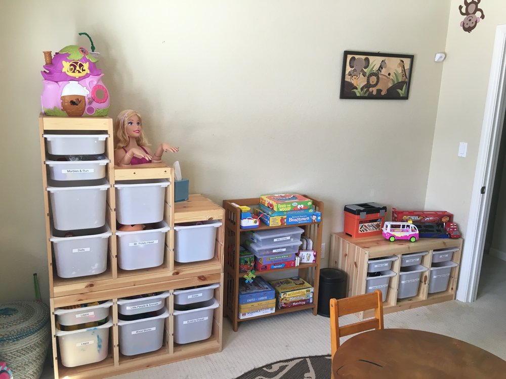 AFTER: pull-out storage bins used to better store toys and for easy kid access.  All were placed along wall so that when walking up stairs, room will appear cleaner.....even if the kids still need to pick up some toys after playing!
