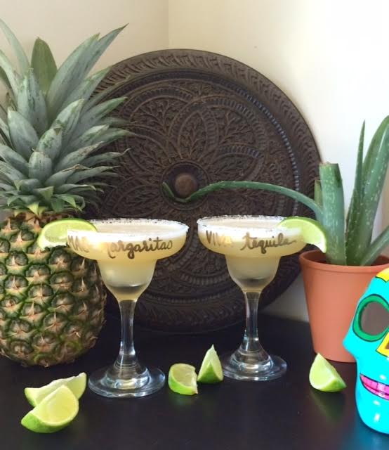 set of 2 margarita glassware with limes and pineapple