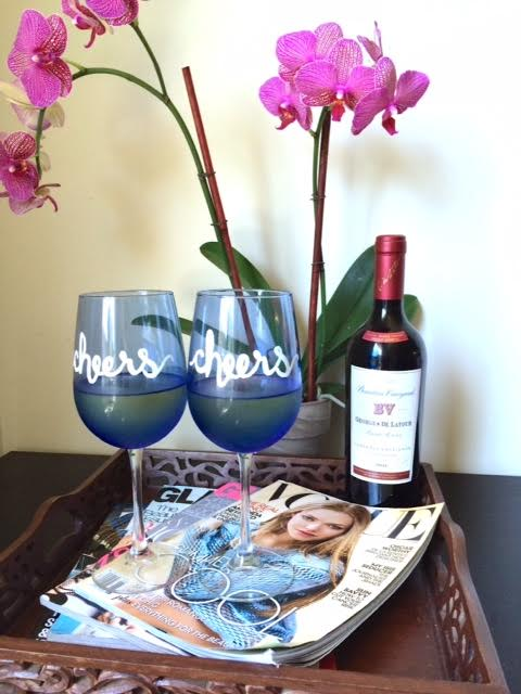 cheers set of 2 blue wine glasses on fashion magazines