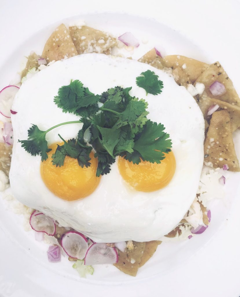 Sunny side up eggs on top of chips