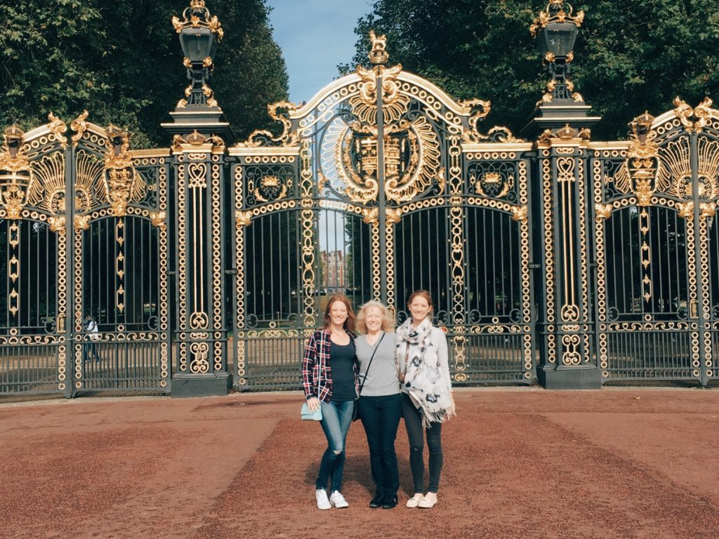 Family in front of gates of Buckingham Palace