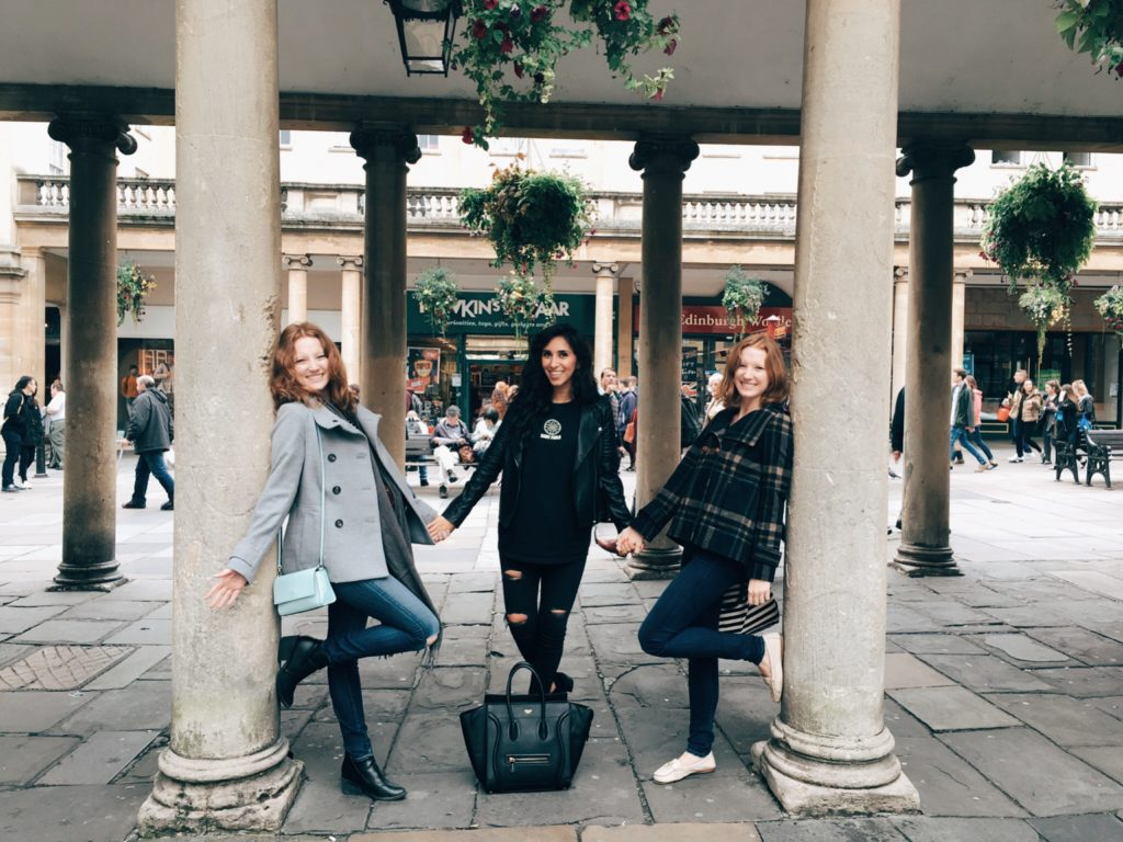 Tourists next to columns in Bath, England