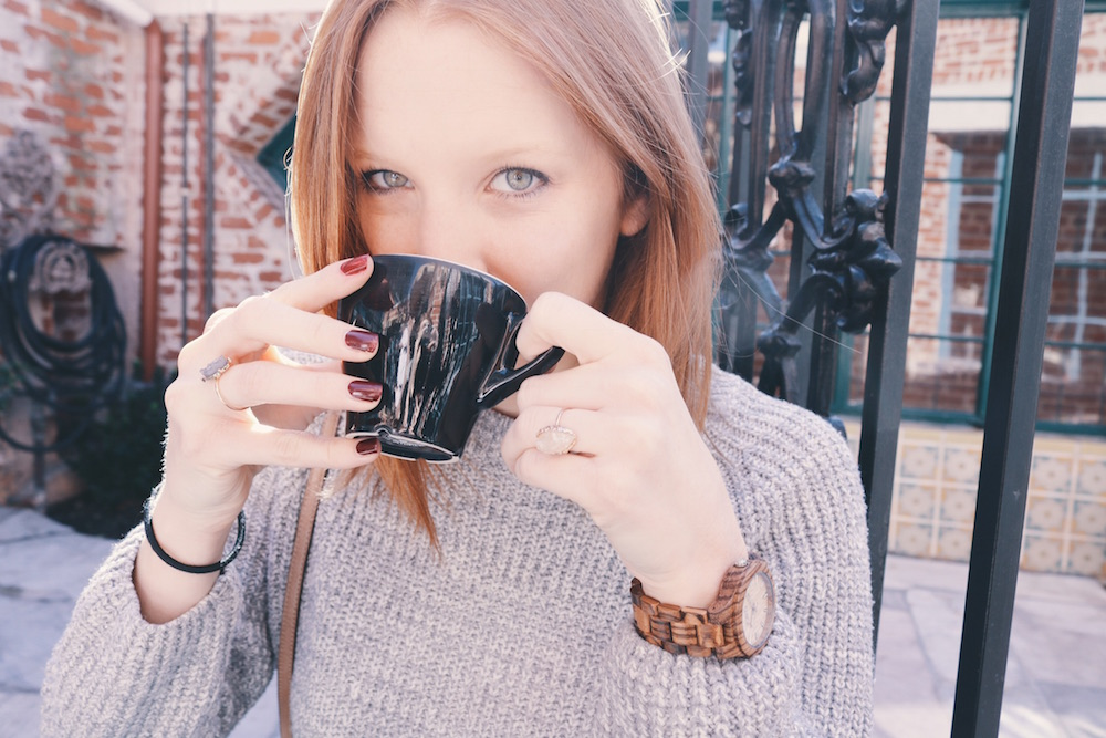 Redhead drinking cappuccino at coffee shop