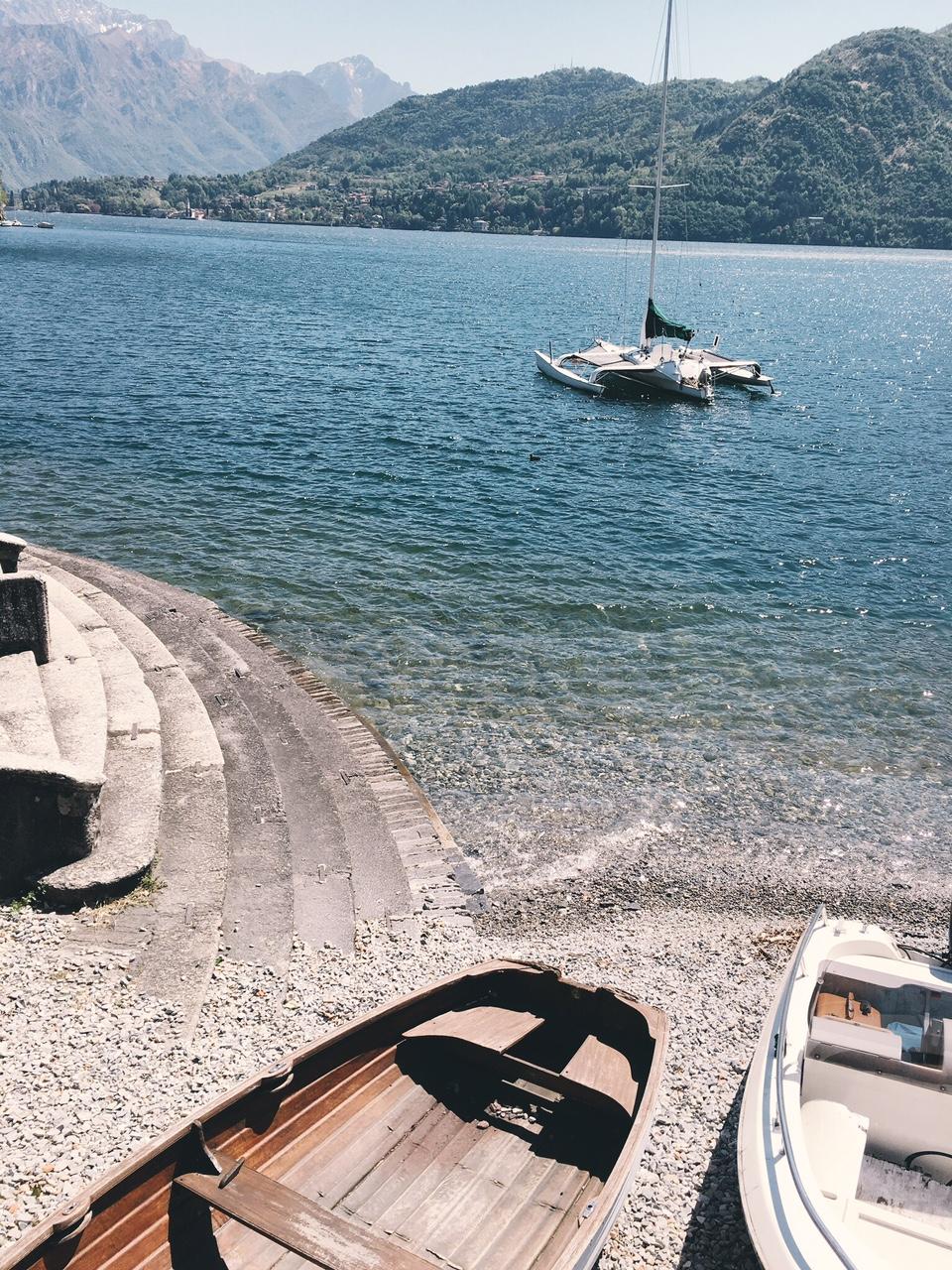 Villa Sola Cabiati outside row boats and steps Lake Como
